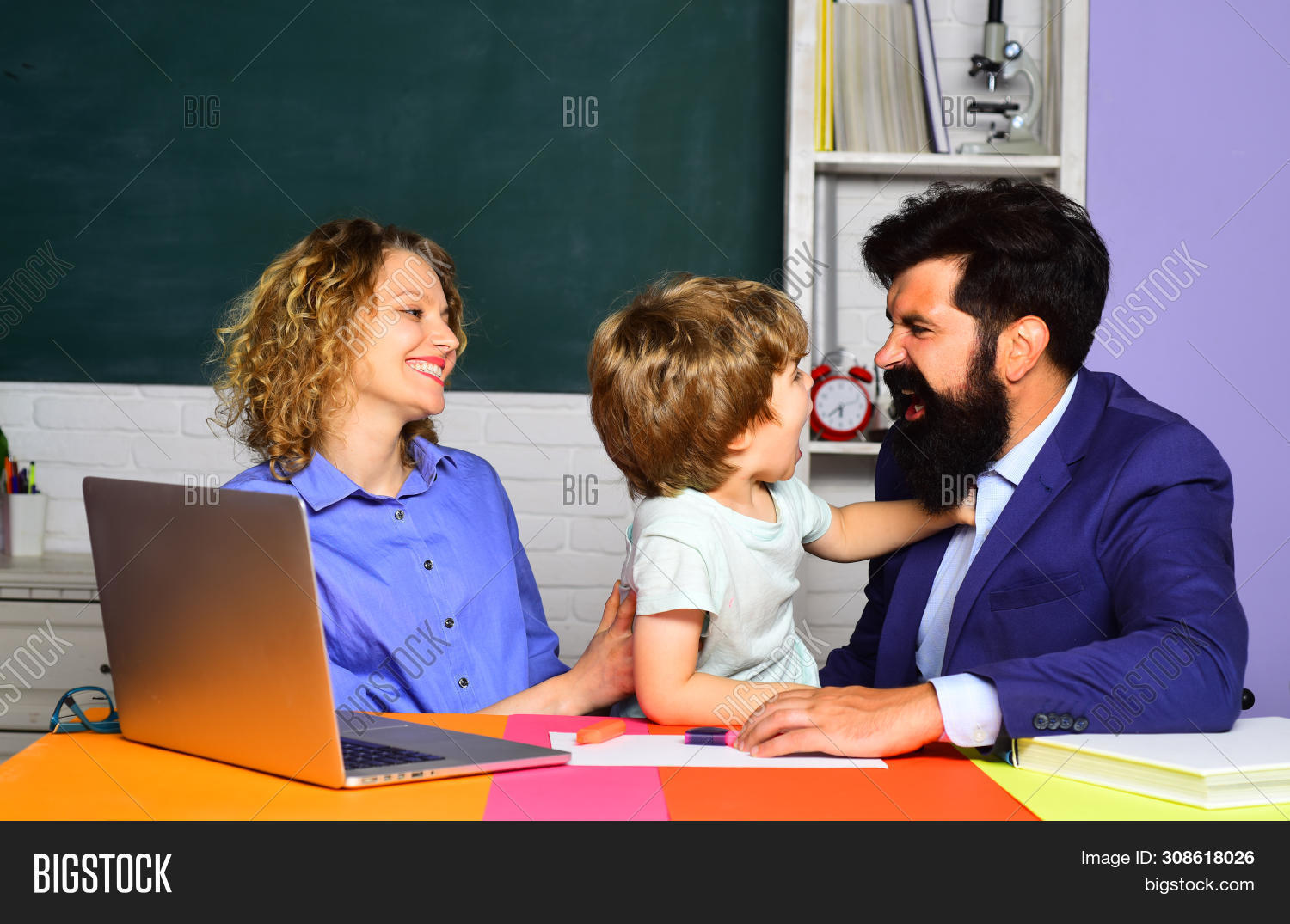 Mother Father And Son Together Schooling. Back To School And Home Schooling. Ready To Study. School