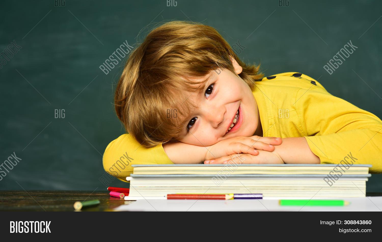 Blackboard Background. Blackboard Copy Space. First School Day. Happy Mood Smiling Broadly In School