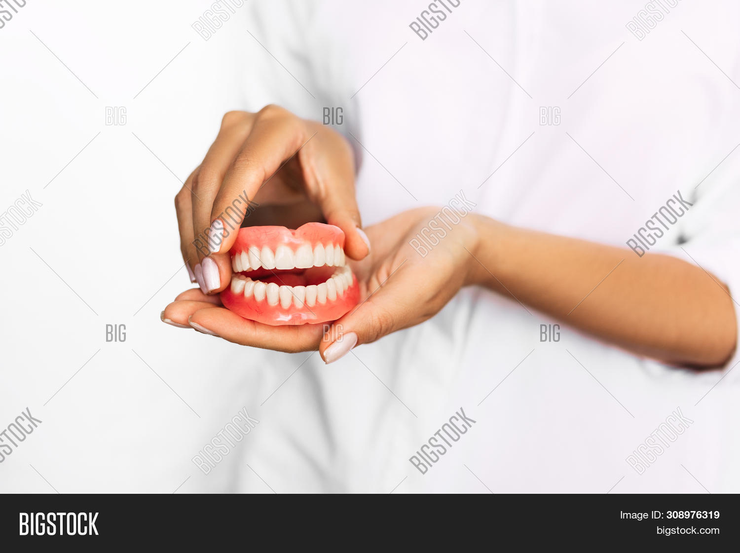 artificial,bridge,care,caries,cavity,ceramic,clinic,closeup,dental,dentist,dentistry,denture,doctor,elderly,false,glove,hand,health,healthy,hold,human,hygiene,jaw,medical,medicine,model,modeling,mouth,orthodontic,orthodontist,plastic,porcelain,profession,professional,prosthesis,prosthetic,prothesis,removable,service,smile,technician,technology,teeth,tooth,treatment,white