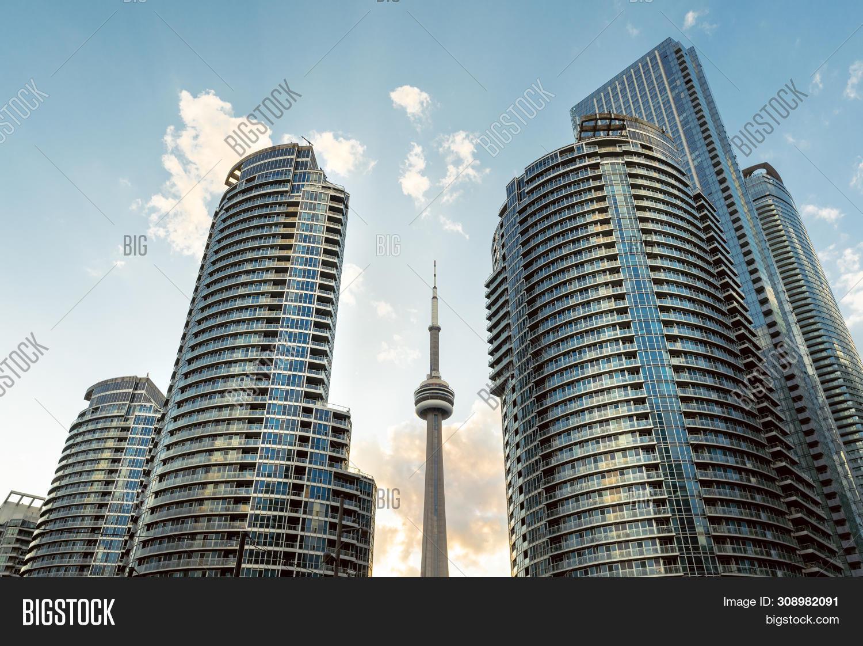 Canada,Toronto,architecture,blue,building,business,city,cityscape,cloud,condo,condominium,construction,district,downtown,dramatic,financial,glass,landmark,office,sky,skyline,skyscraper,sunshine,tower,urban,view,waterfront,window