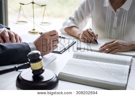 Good service cooperation, Consultation of Businesswoman and Male lawyer or judge counselor having team meeting with client, Law and Legal services concept. stock photo