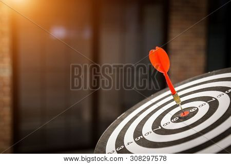 Red dart target arrow hitting on bullseye with,Target marketing and business success concept - Image stock photo
