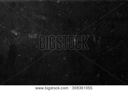 white dust and scratches on a black background. The texture of dirt on the glass. stock photo