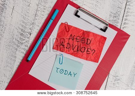 Writing note showing Need Advice Question. Business photo showcasing Asking someone if he want recommendations or guidance Clipboard paper sheet crushed sticky note clip marker wooden background. stock photo