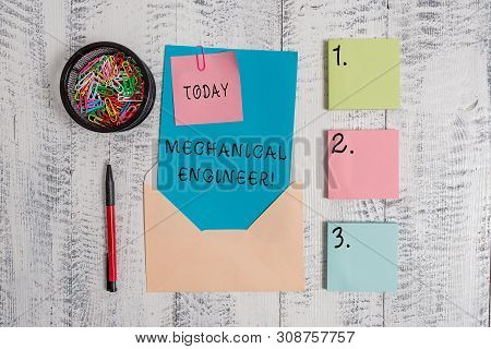 Writing note showing Mechanical Engineer. Business photo showcasing Applied Engineering Discipline for Mechanical System Envelope letter sticky note ballpoint clips on wooden background. stock photo