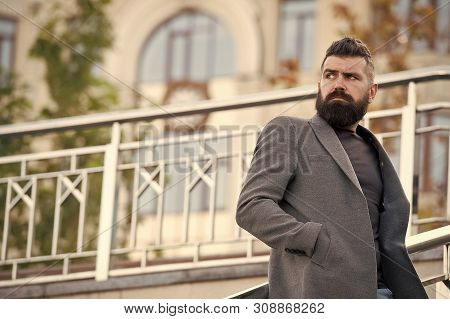 Man bearded hipster stylish appearance waiting someone. Confident hipster. Hipster confident waiting meeting outdoors. Bearded hipster wait partner. Casual and comfortable outfit for autumn date. stock photo