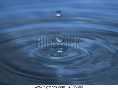 three bigs drops of bluish water background stock photo