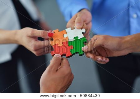 Group of agents collecting jigsaw baffle and speak to group bolster and help idea