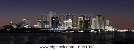Panorama of downtown New Orleans after sunset from across Mississippi River stock photo