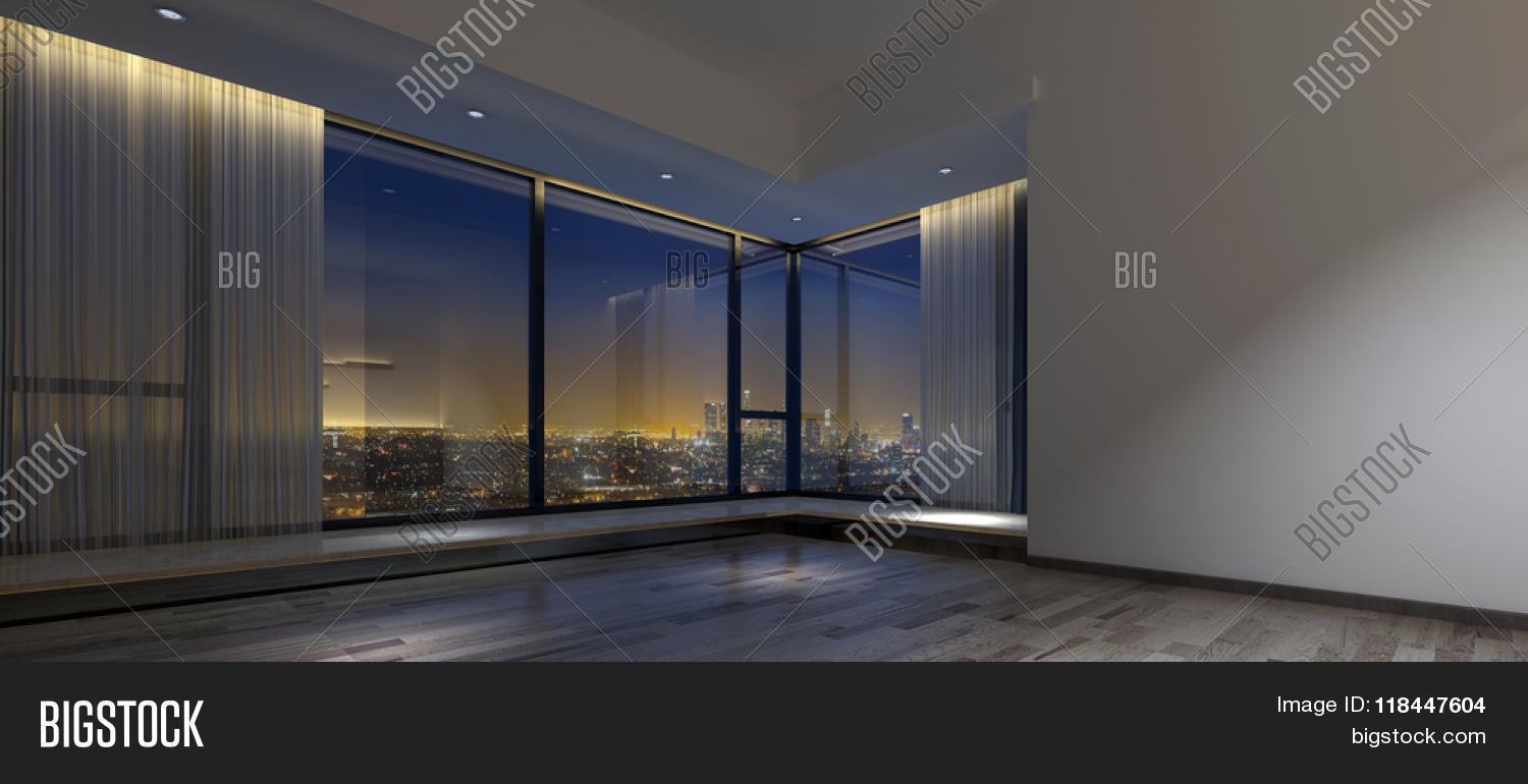 View Of Night Time Skyline From Inside Dim Empty Room With
