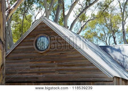 BAROSSA VALLEY AUSTRALIA - JANUARY 5 2016: Exterior of building with old clock face at Rockford Wines Barossa Cellar Door and Sales tourist centre under the canopy of large Australian gum trees. stock photo