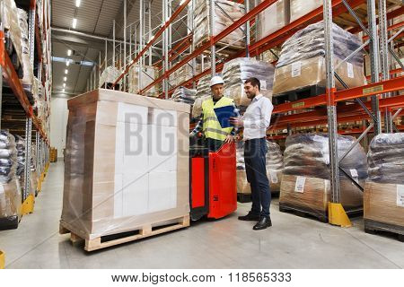 wholesale, logistic, people and export concept - manual worker on forklift loader and businessmen wi