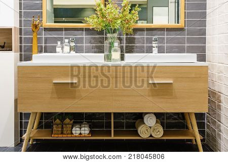 modern bathroom interior in foreground of counter top washbasin in a contemporary style using natural materials. stock photo