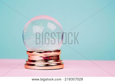 Beautiful snow ball on pink over blue pastel background. stock photo