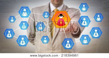 Unrecognizable cyber security manager identifying inside attack in a corporate network. Information technology concept for insider threat cybersecurity corporate espionage and criminal profiling. stock photo
