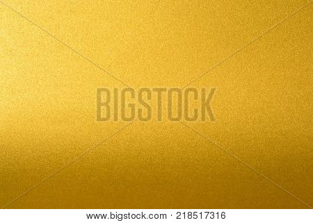 Details of golden texture background with gradient and shadow. Gold color paint wall. Luxury golden background and wallpaper. Gold foil or wrapping paper stock photo