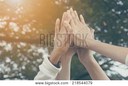 Team work and together concept Hand of people high five for tag team