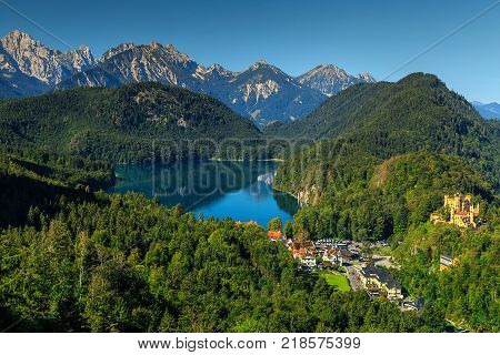 Stunning alpine landscape with glacier lakes, high mountains and Hohenschwangau castle near famous Neuschwanstein castle, Bavaria, Germany, Europe stock photo
