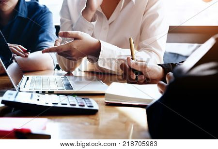 business meeting business woman Explain analyze the company's sales plan to team leader and business owner by use computer laptop calculator stock maket chart on wood desk in conferance.