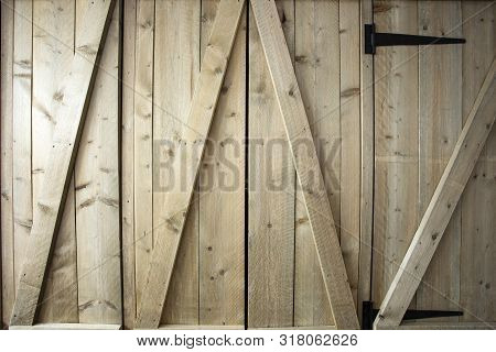 Traditional wooden barn doors detail of farm house doors, close-up clean and modern background textue stock photo