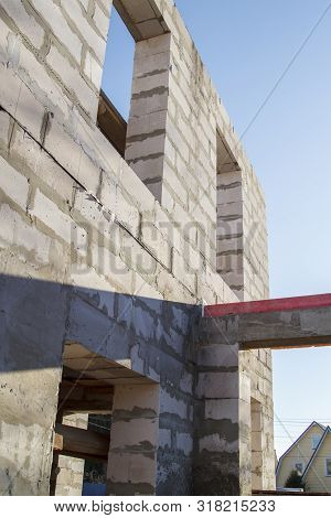 exterior of a country house under construction. Site on which the walls are built of gas concrete blocks stock photo