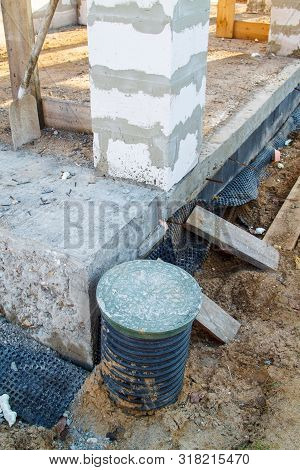 concept of alteration of construction at customers request. Load-bearing columns made of foam block are taken out of  perimeter of foundation by 10 centimeters to increase space on veranda stock photo