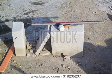construction site on which the walls are built of gas concrete blocks and hammer stock photo