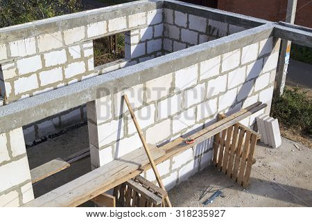 Construction site on which the walls are built of gas concrete blocks stock photo