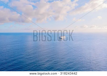 Car carrier shipping out trade port blue sea. Aerial top view stock photo