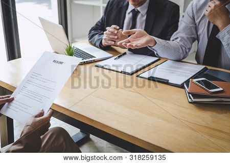 Job interview, Two selection committee manager asking questions to applicant about work history, colloquy dream,  Skill, expertise, experience and businessman listen to candidate answers. stock photo