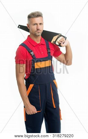 Sharp and dangerous. Builder worker carpenter handyman hold saw white background. Man serious face expression hold handsaw in hand. Brutal worker concept. Dangerous works. Dangerous job. stock photo