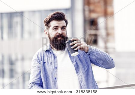Great ideas come from great coffee. Man drink take away coffee. Bearded man relax outdoors. Coffee break concept. Caffeine addicted. Morning coffee. Mature hipster enjoy hot beverage. Making sip. stock photo