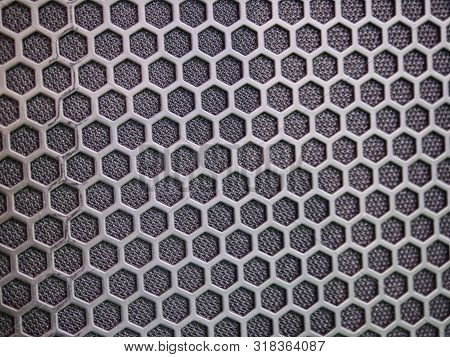 Modern acoustic systems. Metal grating on the sound dynamics. Abstraction and background. Soft focus and beautiful light. stock photo