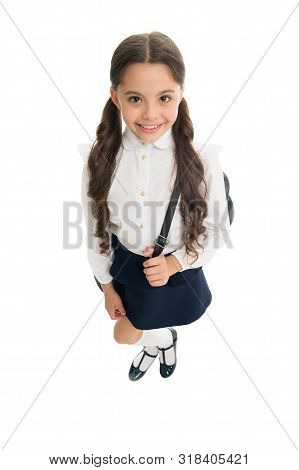 Getting ready. Fit backpack correctly. Girl little fashionable cutie carry backpack. Popular useful fashion accessory. Schoolgirl ponytails hairstyle with small backpack. Carrying things in backpack. stock photo