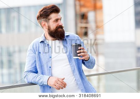 Coffee completes me. Caffeine addicted. Morning coffee. Mature hipster enjoy hot beverage. Make yourself useful. Man drink take away coffee. Bearded man relax outdoors. Coffee break concept. stock photo