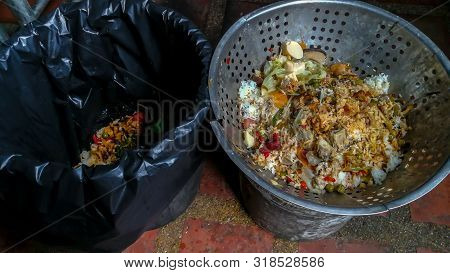 Flat lay view of container full of domestic food waste ready to be composted in the home garden. Food recycling and environment concept. copy space stock photo