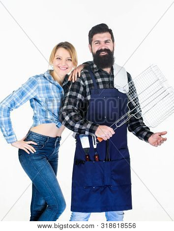 Make it tasty. Picnic and barbecue. Family barbecue concept. Barbecuing common technique. Bearded hipster and cheerful girl hold cooking grilling utensils white background. Essential barbecue dishes stock photo
