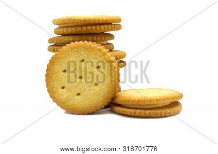 Biscuit sandwich cracker Cheese flavoured ,Cream and butter. Stack of crunchy delicious sweet meal and useful cookies. Isolated on white background. stock photo