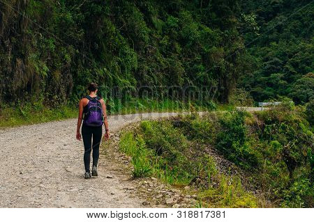 adventure travel photo. tourist on the road of death in bolivia stock photo