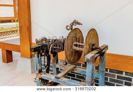 Mechanical apparatus used to twist rice straw into rope on display in public park. stock photo