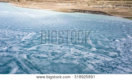 Blue Ice surface of Frozen Lake from drone aerial view at Pangong Lake or Pangong Tso, Tso moriri - Nubra, India. Abstract concept of Cold winter, peaceful and freedom. stock photo
