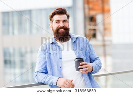 Coffee completes me. Make yourself useful. Man drink take away coffee. Bearded man relax outdoors. Coffee break concept. Caffeine addicted. Morning coffee. Mature hipster enjoy hot beverage. stock photo