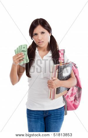 Ethnic Hispanic college student with notebook and backpack holds pile 100 (one hundred) dollar bills happy getting money frustrated by exuberant raising tuition cost and unaffordable education forcing into debt stock photo