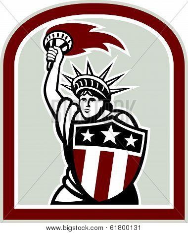 Illustration of statue of liberty holding up a flaming torch and shield on isolated background done in retro style. stock photo