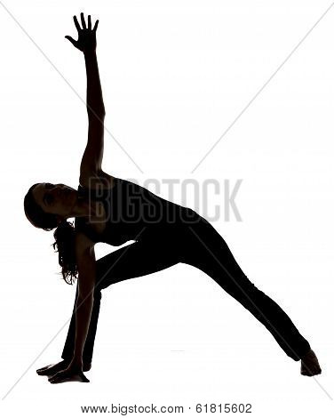 Young woman is doing Extended Side Angle Pose in Yoga. stock photo