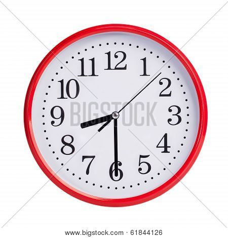 Half past eight on a red round clock face stock photo