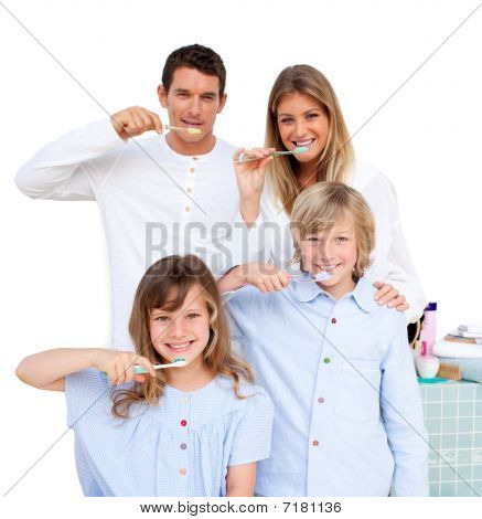Merry Entire Smiling Family Brushing Their Teeth stock photo