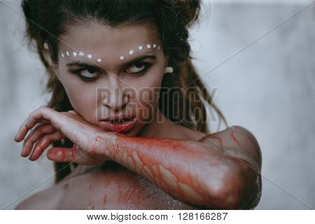 Photos of wild woman showing blood and gore dripping from the mouth stock photo
