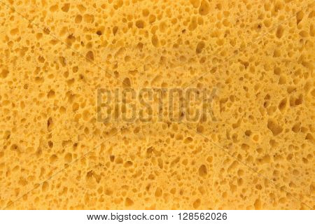Close-up Of New And Clean Yellow Sponge Textured Background With Copy Space stock photo