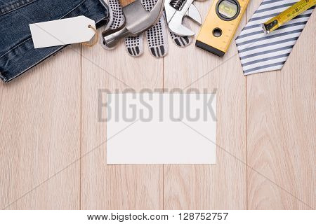 Greeting Card for Father\'s Day. Fathers day composition - office desk. Studio shot on wooden background.